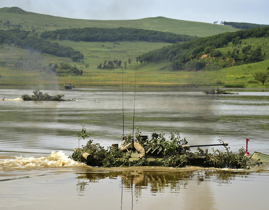 A BMP-2 amphibious infantry fighting vehicle during assault crossing exercises held by a motorized rifle brigade