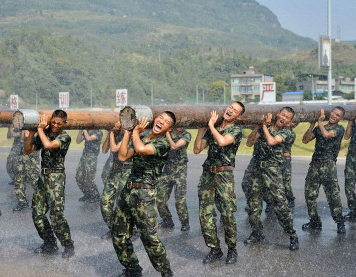 Armed police soldiers lift timbers during a drill on August 24, 2016 in Chongqing, China. As the highest temperatures reached over 40 degree Celsius at 5 districts in Chongqing, officers and soldiers of an armed police crop took outdoor training