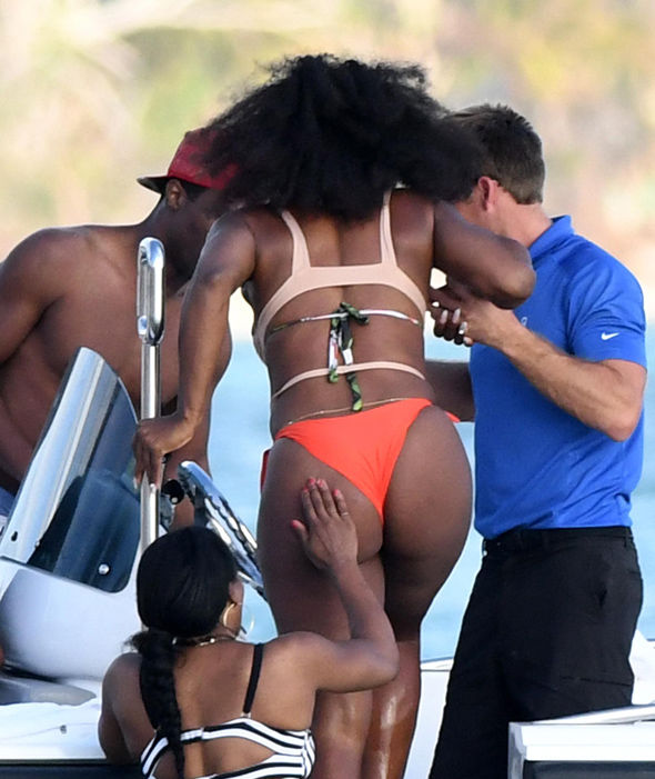 Tennis player Serena Williams shows off her booty in an orange thong bikini