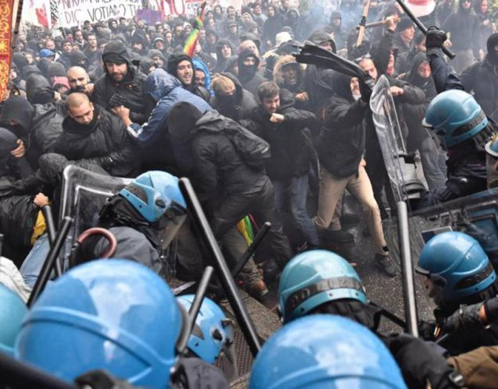 November 2016: Florence erupts in violence as anti-Renzi protesters clash with riot cops. Hooded youths attacked lines of cops protecting embattled prime minister Matteo Renzi, who was in the city for crunch political talks.