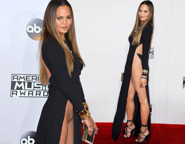 Chrissy Teigen suffers an epic wardrobe malfunction as she goes knickerless at the AMA's