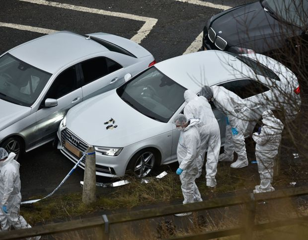 A forensics team examines the scene just off Jct 24 of the M62 near Huddersfield, West Yorks., where police have shot and killed a man during a pre-planned operation, January 03, 2017.