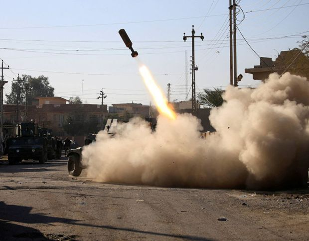 Members of the Iraqi rapid response forces fire missile toward Islamic State militants during a battle between Iraqi forces and Islamic State militants in Somer district of eastern Mosul
