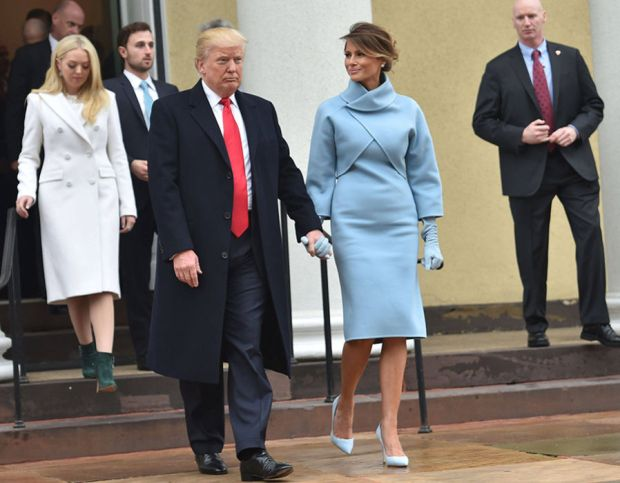 US President-elect Donald Trump and his wife Melania leave St. John's Episcopal Church on January 20, 2017, before Trump's inauguration.