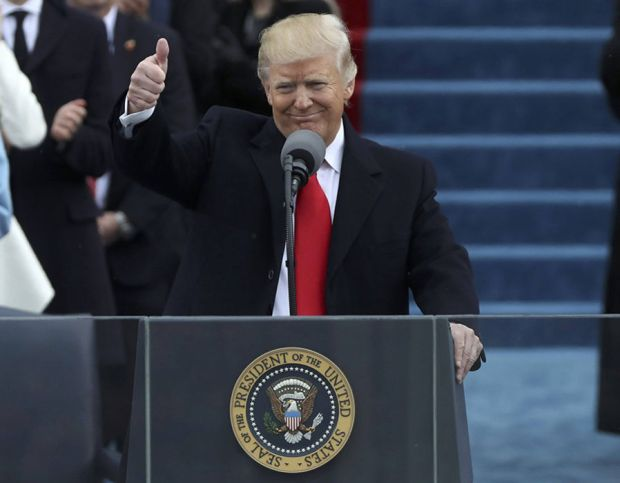 U.S. President Donald Trump gives a thumbs up after being sworn in as the 45th president of the United States on the West front of the U.S. Capitol in Washington