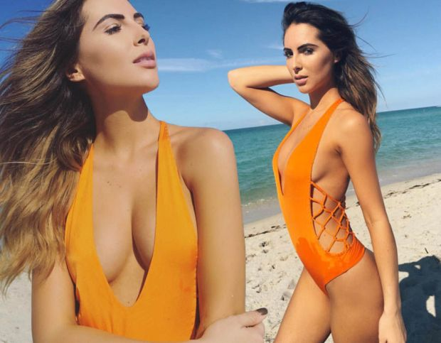 Brittny Ward sizzles in plunging orange swimsuit