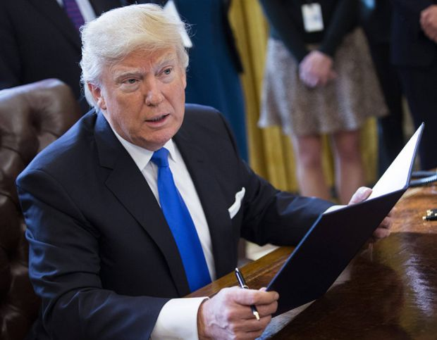 US President Donald Trump delivers remarks after signing five executive orders related to the oil pipeline industry in the oval office of the White House in Washington, DC, USA