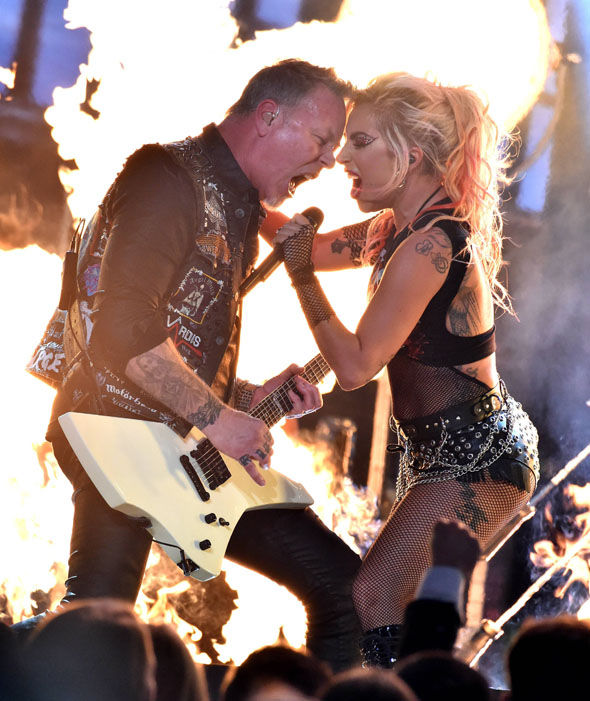 James Hetfield of Metallica (L) and Lady Gaga perform onstage