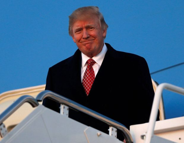 FILE PHOTO:  U.S. President Donald Trump arrives aboard Air Force One at Joint Base Andrews, Maryland