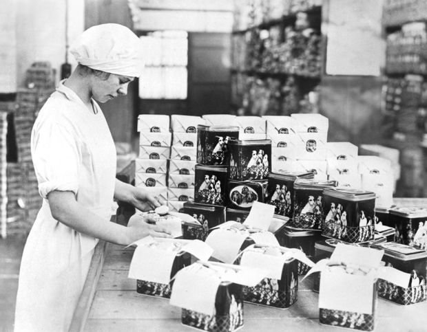 Packing fancy tins with biscuits in the Co-operative Wholesale Society biscuit factory at Crumpsall, near Manchester. - 1929