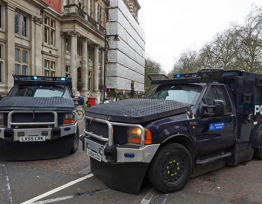 Armoured police personnel carriers are seen on a street leading to the Houses of Parliament in central London on March 24, 2017 two days after the March 22 terror attack on the British parliament and Westminster Bridge