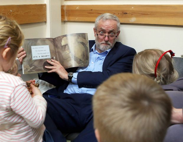 Labour leader Jeremy Corbyn reads with children as he visits Brentry Children Centre in Bristol, during Labour's election campaign