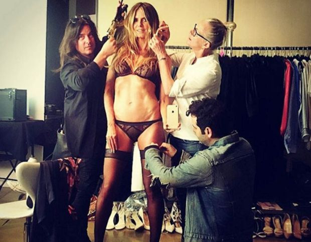 Heidi Klum flaunts her supermodel figure in very racy sheer lingerie