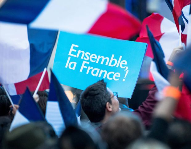 Macron's slogan is visible in the crowd –translated, it means