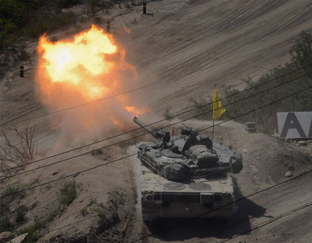A South Korean tank of the 8th Mechanized Infantry Division takes part in a live-fire exercise at a training ground in Cheorwon, near the demilitarized zone (DMZ)