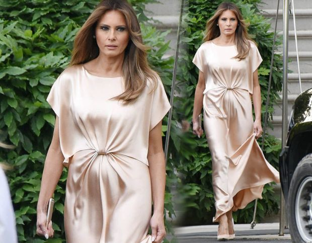 Melania Trump shows off her curves in floor-length satin gown