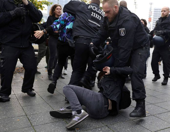 Demonstrators scuffle with police during the protest against the anti-immigration party Alternative for Deutschland AfD, after German general election (Bundestagswahl) in Berlin