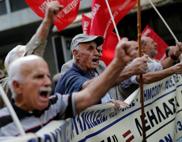 Greek pensioners shout slogans during a demonstration against planned pension cuts in Athens