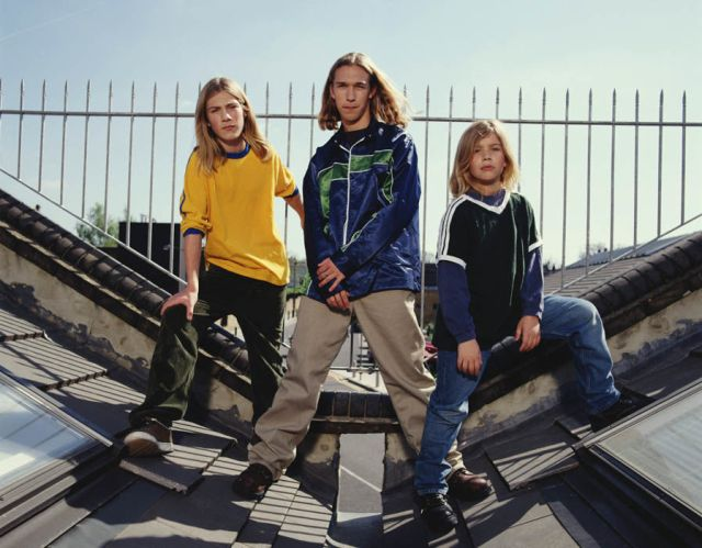 American pop band Hanson pose for a group portrait on a roof in London, 1997