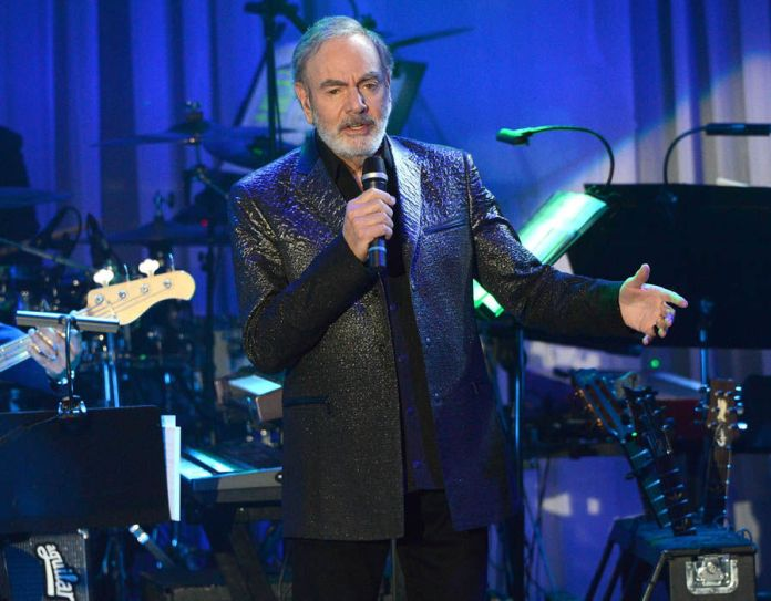Neil Diamond announced his retirement from concert touring after being diagnosed with Parkinson's disease