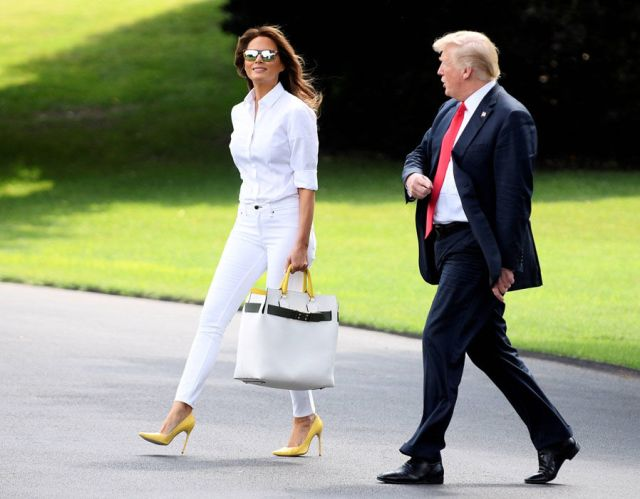 US President Donald Trump and First Lady Melania Trump walk to Marine One from the White House