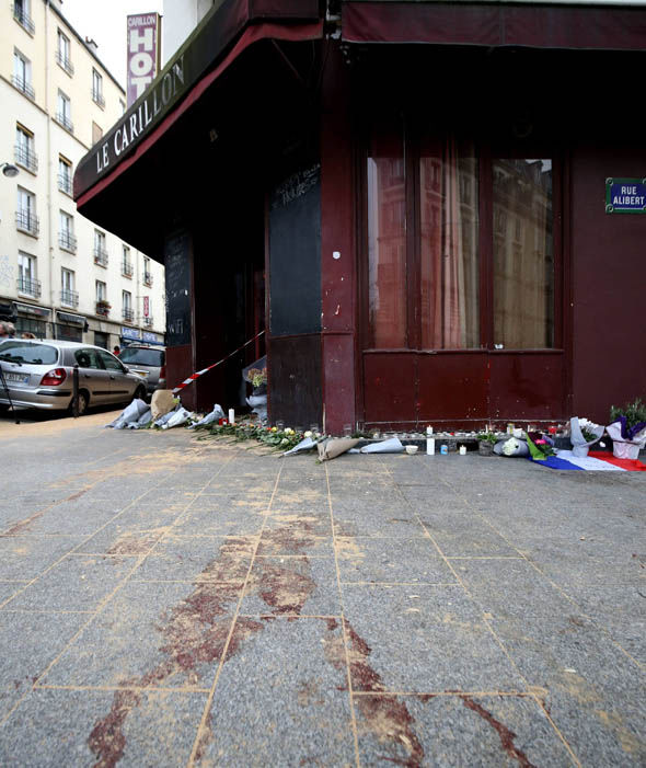 Blood and tributes on the left outside Le Carillon bar, Paris