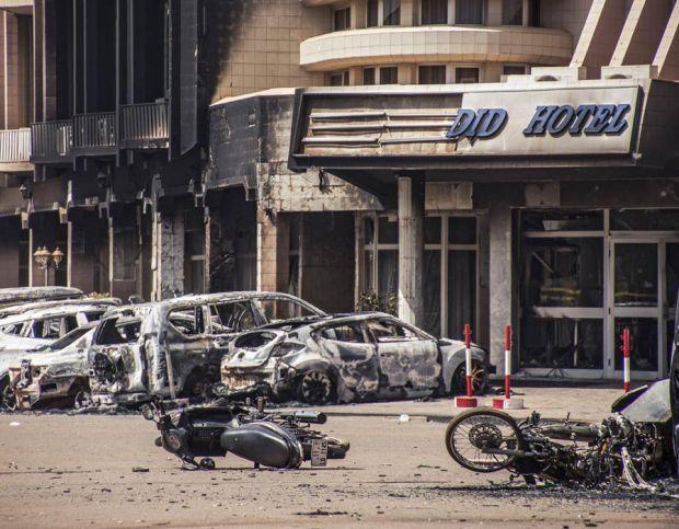 Damaged vehicles outside hotel Burkina Faso