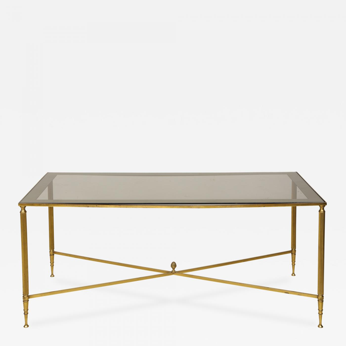 brass cocktail table smoked glass top on stretchers base