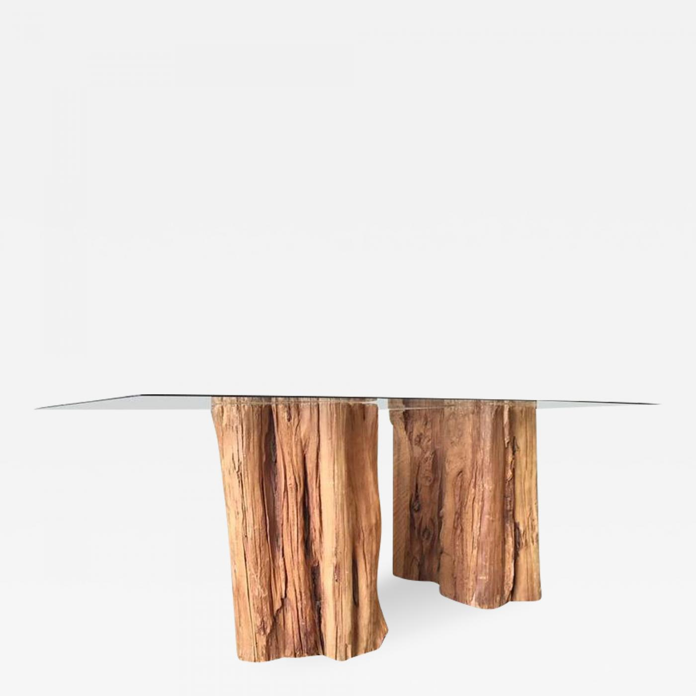 ipe wood trunk pedestal dining table with glass top