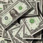 piles of us dollars usd