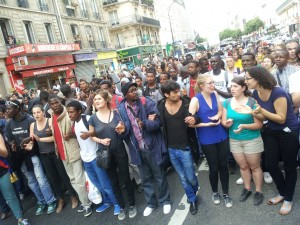 Activists and migrants protest evictions in Paris. Credit: Amnesty International France