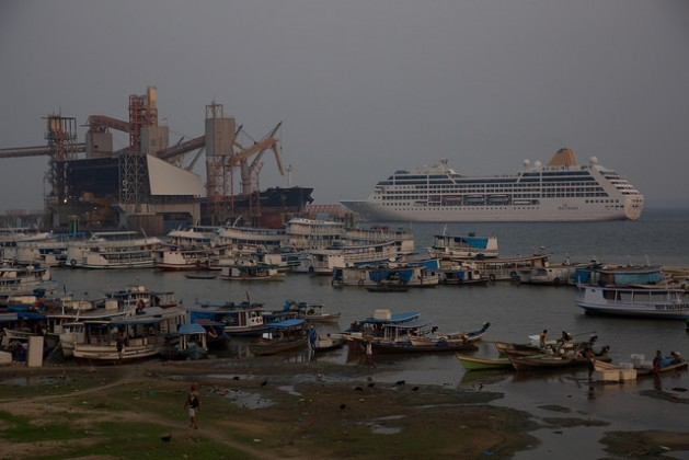 The U.S. agribusiness giant Cargill's port terminal on the banks of the Tapajós River in the northern Brazilian city of Santarém, where large cargo vessels dwarf the traditional small fishing boats of the Amazon basin. Credit: Fabiana Frayssinet/IPS