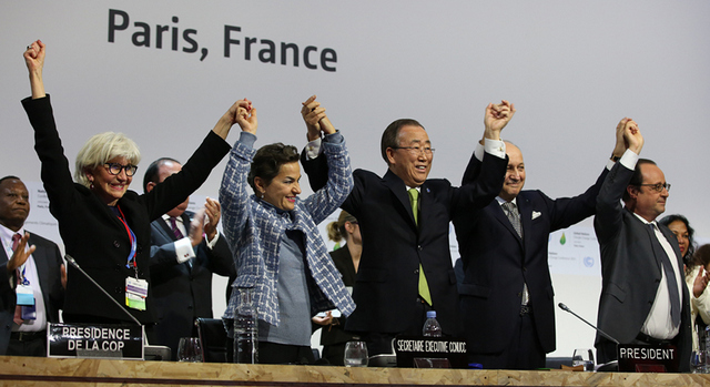 On Dec. 12, 2015, at the end of COP 21, United Nations Secretary-General Ban Ki-moon (centre) and other dignitaries celebrated the historic Paris Agreement on climate change, to be signed this week in New York. Credit: United Nations