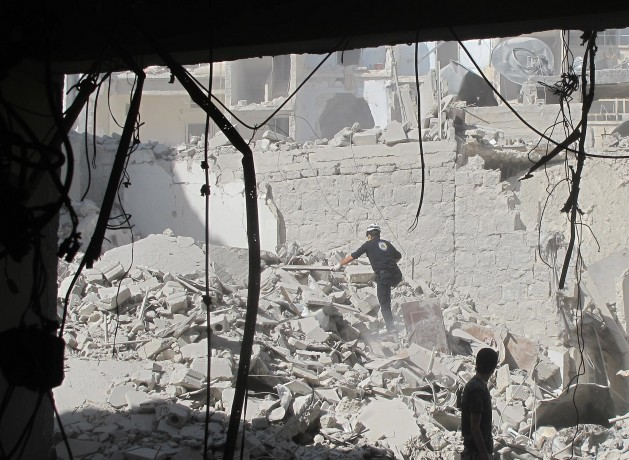 A civil defence team in Aleppo, Syria searches for survivors after a barrel bomb attack in August 2014. Credit: Shelly Kittleson/IPS