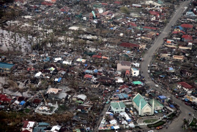 Tacloban, in the Philippines, one of the areas hit hardest by super typhoon Haiyan in November 2013. The disaster coincided with the COP19 climate talks and served as the backdrop for negotiations on mechanisms of damage and losses. Credit: Russell Watkins/Department for International Development