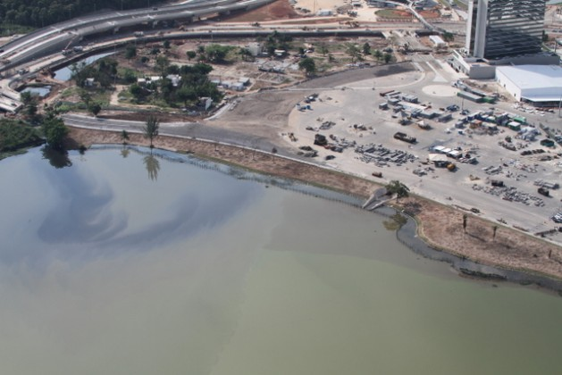 Raw sewage stains in Jacarepaguá lagoon alongside the Olympic Park, where the Olympic Games are to be held August 5-21 in the Brazilian city of Rio de Janeiro. Foul mud was to be dredged from the lagoon but this was not carried out because of funding cuts. Credit: Courtesy of Mario Moscatelli