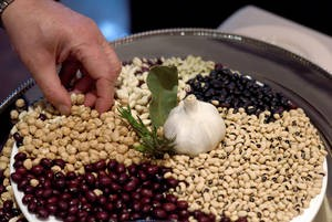 Lovers of peas, pinto beans, lentils and their leguminous cousins can now boost their appetites and cooking skills thanks to a colorful new book featuring recipes from international top chefs passionate about one of the world's most versatile super foods: pulses. The book was launched in May 2016 by FAO. Photo: Courtesy of FAO