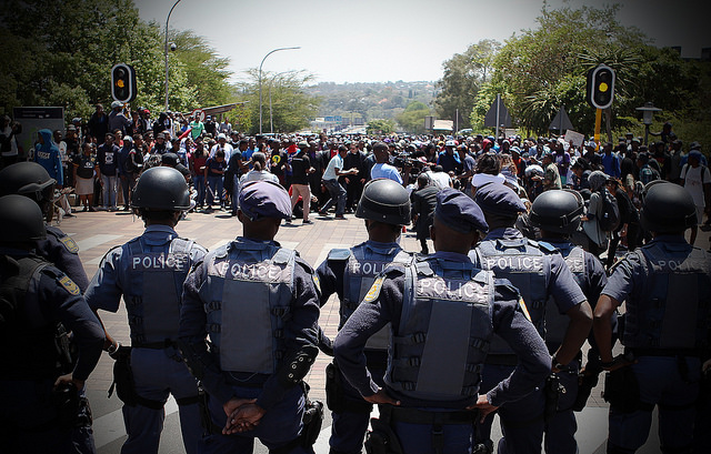 Police face off with student protesters near the Union Buildings in Pretoria, South Africa, on October 20, 2016. Credit: Denvor DeWee/IPS