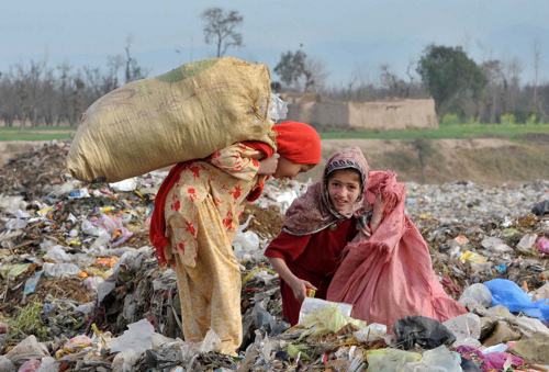Children pick through garbage in the FATA region of Pakistan. Credit: Ashfaq Yusufzai/IPS