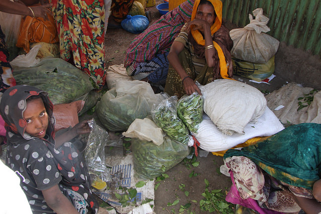A woman and child surrounded by bags of khat they've brought to sell at Dire Dawa's Chattara Market, Ethiopia. Credit: James Jeffrey/IPS