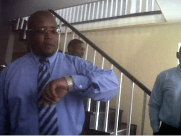 In This Image Captured From Video, &Quot;Sargeant 23 Browne&Quot; Looks At His Watch During The Standoff Before The Arrest Of Vynnette Frederick On Thursday.