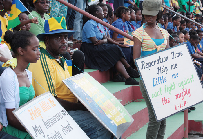Businessman Leon &Quot;Bigger Biggs&Quot; Samuel And His Daughter Picket During The Independence Parade On Sunday. (Iwn Photo)