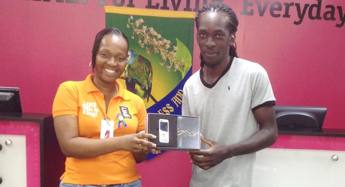 Delroy Garraway Receives A Handset From A Lime Representative.