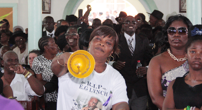 A Woman Rings A Bell In Protest Against Gonsalves Delivering A Tribute At The Funeral. (Iwn Photo)