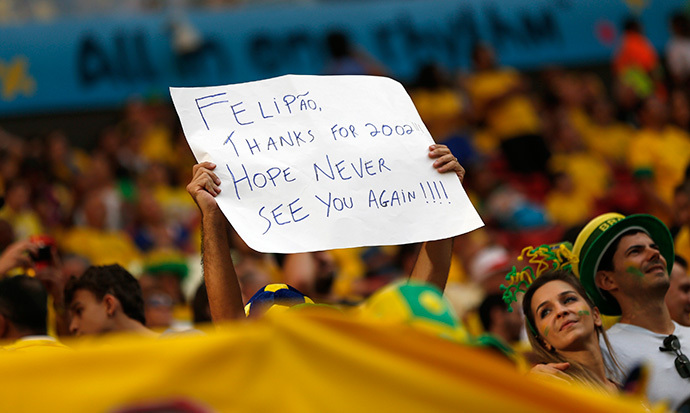 A Brazil Fan Waves A Sign Targeted At Brazil'S Coach Luiz Felipe Scolari Before The 2014 World Cup Third-Place Playoff Between Brazil And The Netherlands At The Brasilia National Stadium In Brasilia July 12, 2014. (Reuters / Ueslei Marcelino)