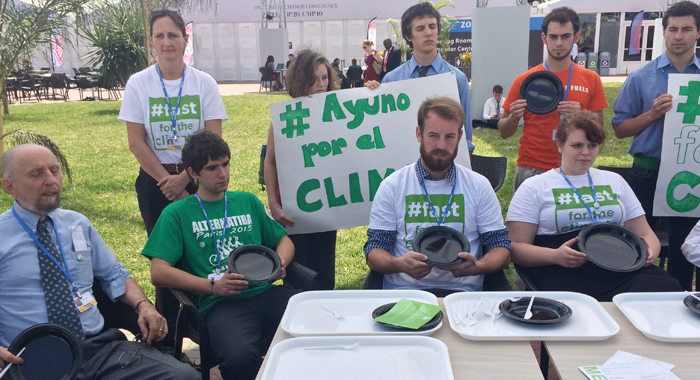 Activists Past At The Change Summit Venue On Monday To Highlight The Impact Of Climate Change On Food Security. (Iwn Photo)