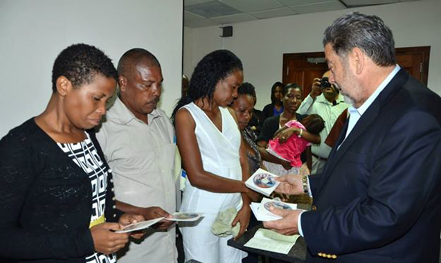 Prime Minister Gonsalves Presents Cd To Relatives Of Victims Of The Tragedy On Tuesday. (Photo: Lance Neverson/Facebook)