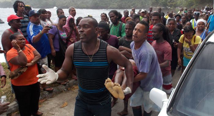 Men Carry The Body Of A Female Studentsafter It Was Recovered From The Sea On Monday. (Iwn Photo)