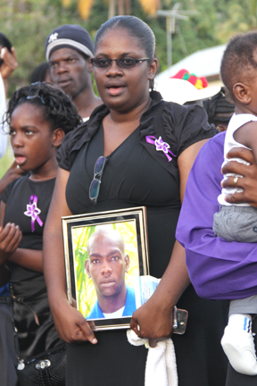 Nick'S Sister-In-Law, Symantha Chance, Hold His Portrait At The Graveside On Sunday. (Photo: Karamo John)
