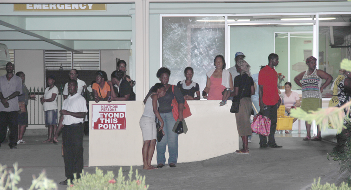 Persons Gather Outside The Accident And Emergency Ward Of The Milton Cato Memorial Hospital, Where Primus Was Taken After The Stabbing. (Iwn Photo)